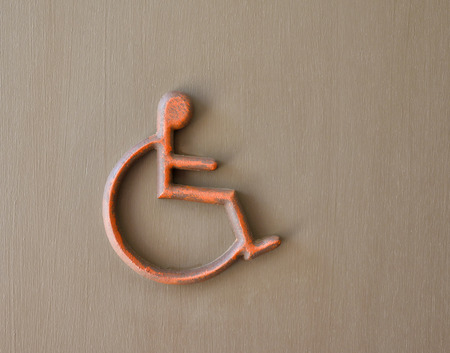 pannel: metal  handicapped sign on wood panel