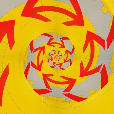 komplizierte Spiralvariationen durch das Design, die alle auf einem einzigen roten Pfeil auf einem leuchtend gelben Hintergrund basieren