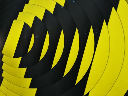 intricate concentric pattern through design all based on multiple black diagonal on a vibrant yellow chevron