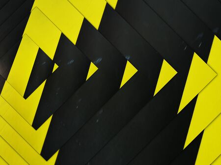 intricate concentric variations through design all based on multiple black diagonal on a vibrant yellow chevron