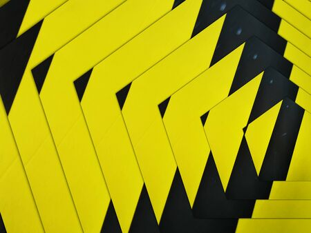 intricate concentric pattern all based on multiple black diagonal on a vibrant yellow chevron Archivio Fotografico