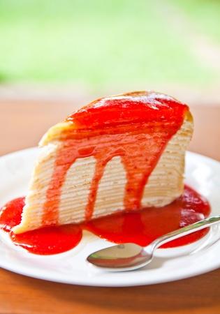 Crape cake with strawberry sauce photo
