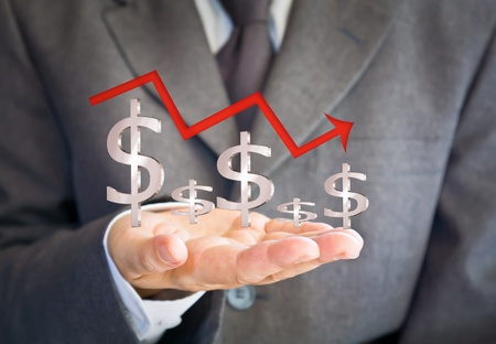 Business man showing dollars sign graph photo