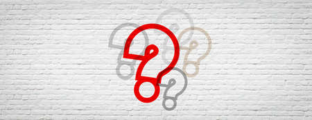 Question marks on brick wall banner