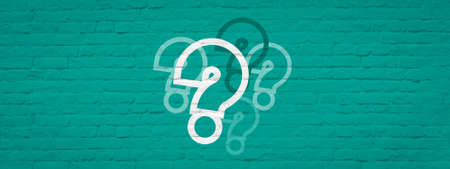Question marks on brick wall green banner