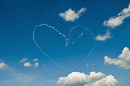 manoeuvre: Air Show White Smoke Heart On Blue Sky with White Clouds Stock Photo