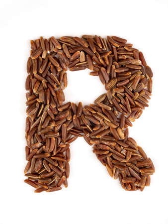 Letter R of the English alphabet made from brown rice on an isolated background.