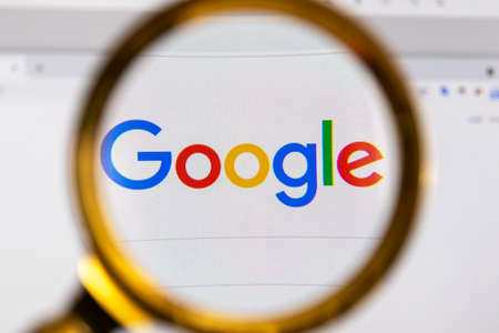Moscow, Russia - 31 March 2021: View the Google homepage through a golden magnifier, company logo. High quality photo