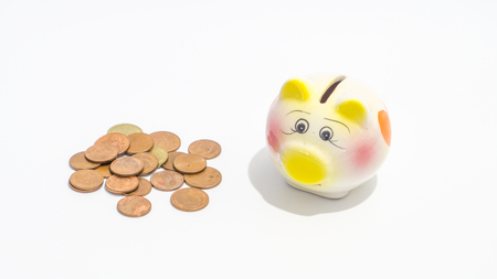 Small piggy bank money box with thai bath coins put on the table., saving concept. business concept. family concept. Stock Photo