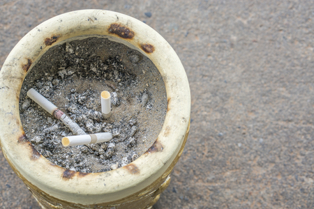 Big pile of put out cigarettes in an ashtray. Smoking,addiction, health hazard, lung cancer concept. , copy space. health concept. cancer concept. Stock Photo