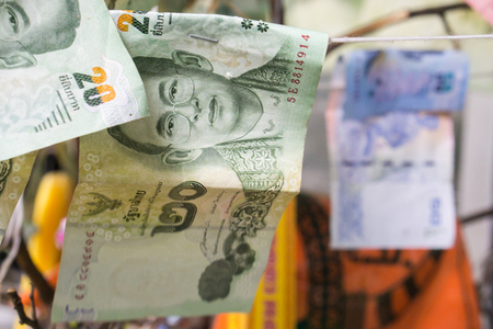 Thai Banknotes , Thai money: closeup of banknotes , thai bank for donation at the temple Stock Photo
