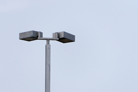 street light electricity front view isolated with blue sky., with copy space