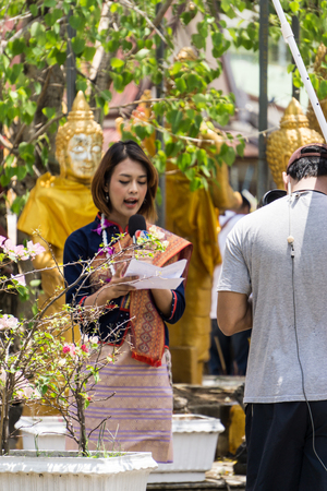 khonkean, Thailand - 13 april 2017: Unidentified news reporter reports for people in songkran day at the Temple.