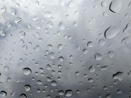 Raindrop falling on the window glass car. Stock Photo