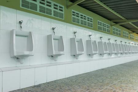 Raw of outdoor urinals men public toilet., design of white ceramic urinals for men in toilet room. men public toilet concept. Stock Photo