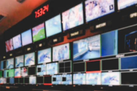 Blur image video switch of Television Broadcast, working with video and audio mixer, control broadcasts in recording studio. Stock Photo