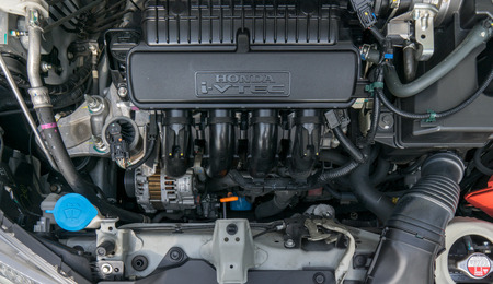 Bangkok, Thailand, March 25, 2018 : Closeup of engine in Honda New Jazz 2017 V-tec model., From HONDA mechanic service in auto repair service.