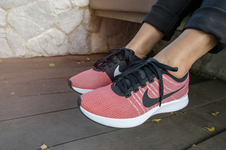 Bangkok, Thailand - May 8, 2018: The NIKE pink shoes with red box of women for exercise at the park., Nike Womens Free Run Flyknit 2 - Fire Pink/Black-Hyper Grape-Racer Pink.