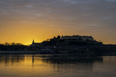 Morning sunsnet view on historical Petrovaradin fortress and Danube river, Novi Sad, Serbia