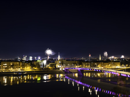 Novi Sad, Serbia-January 1, 2018: Fireworks on New Years Eve in city center, view from Petrovaradin fortress on a city skyline