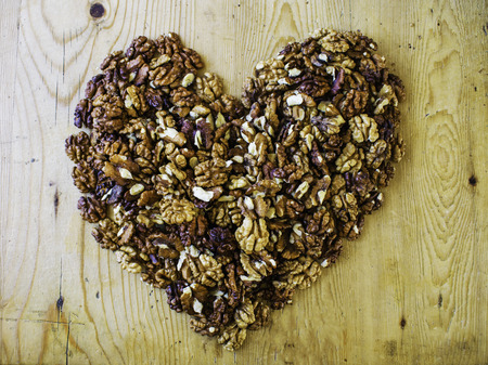 Walnuts in shape of a heart on beautiful wooden tabletop, concept of heart health, walnut has good kinds of fat, Valentines day concept
