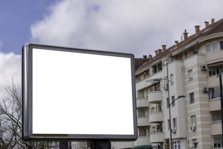 Blank billboard in front of apartment building