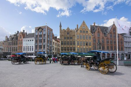 Horse carriages on Market square (Grote markt), Bruges, Belgium