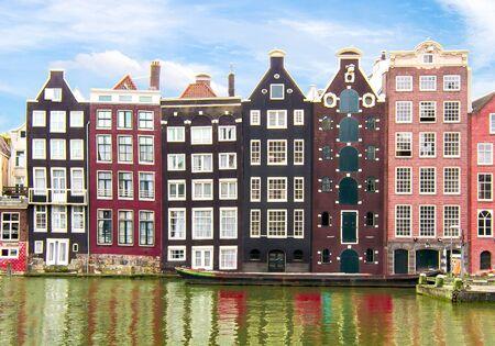 Buildings on Damrak canal, Amsterdam architecture, Netherlands Banco de Imagens