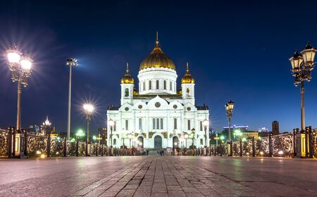 Cathedral of Christ the Savior (Khram Khrista Spasitelya) and Patriarshy bridge at night in Moscow, Russia