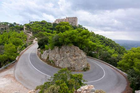Twisting road on Sant Salvador mountain, Mallorca island, Spain