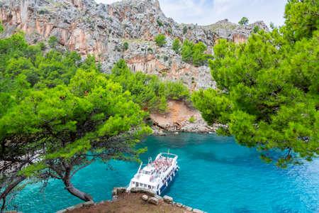 Cruise boat in Sa Calobra bay, Mallorca island, Spain