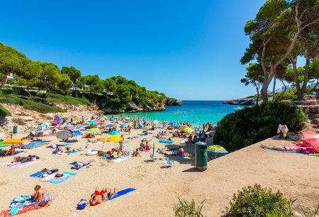 Mallorca, Spain - September 2019: People on Esmeralda beach in Cala D'Or