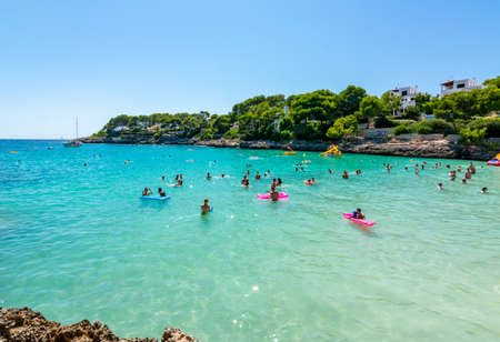 Mallorca, Spain - September 2019: People swimming in Cala Gran bay in Cala D'Or