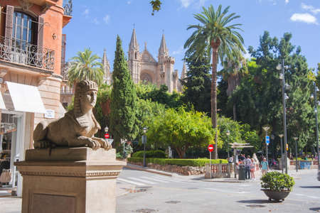 Sphinx statue on Passeig del Born street with Cathedral at background, Palma de Mallorca, Balearic islands, Spain Editorial