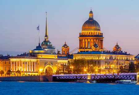 Saint Petersburg cityscape with St. Isaac's cathedral, Admiralty building and Palace bridge at sunset, Russia