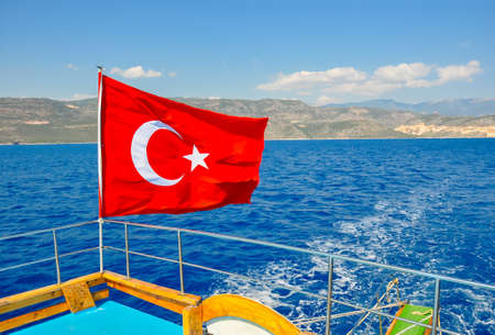 Flag of Turkey on cruise boat sailing in Mediterranean sea near Antalya, Turkey Banco de Imagens