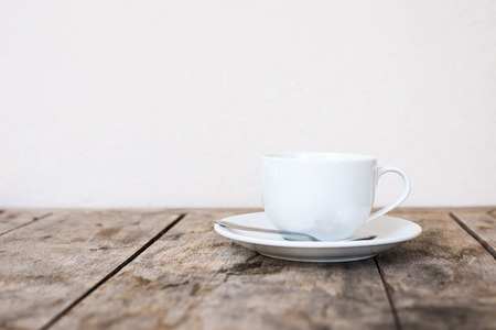 light breakfast: White cup on wood table