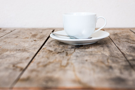 breakfast room: White cup on wood table