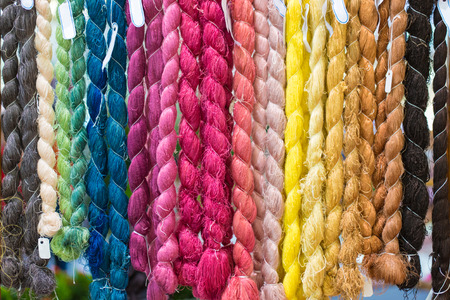 Colorful raw silk thread background photo