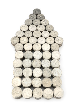 Arrow of coins on white background photo