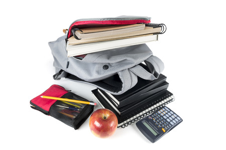 Backpack full of school supplies. on white background. Stock Photo