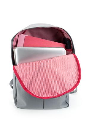 Backpack full of school supplies. on white background. Zdjęcie Seryjne