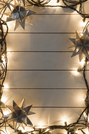 holiday garland: Christmas lights on wooden background Stock Photo