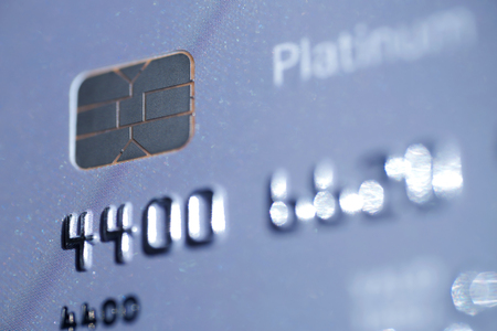 bankcard: Low key macro shot with old credit card. Stock Photo