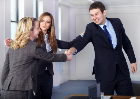 Businesswoman introduce two colleagues, welcome handshake before business meeting photo
