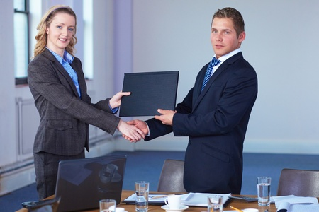 handshake after contract signing, business office shoot photo