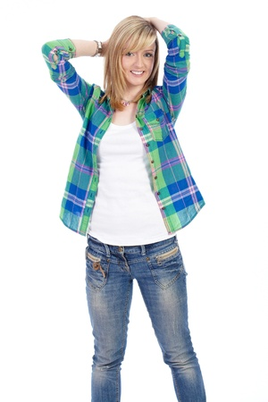 Happy attractive blonde female in shirt and jeans shoot over white background Stock Photo - 11477079