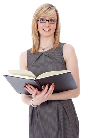 Young attractive blonde businesswoman holds black leather diary, isolated on white photo
