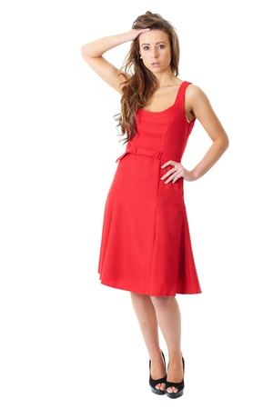 Young very attractive female in red dress pose over white background photo