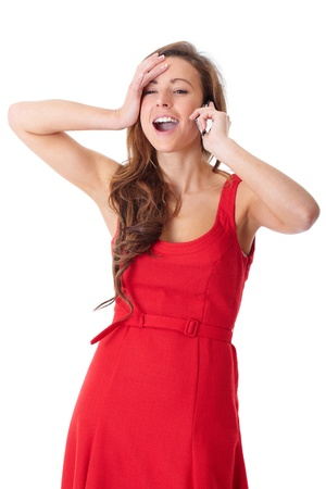 Young happy attractive female in red dress chat over mobile phone, shoot over white background photo